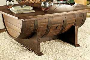 This Whiskey Barrel Coffee Table Conceals Storage Space Within