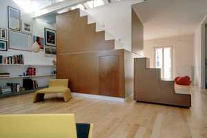 Departamento CUBO by Studioata Makes Stairs Storage and a Focal Point
