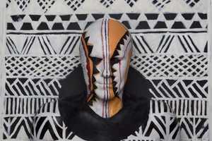 Swarte Explores Tribe Survival Through Tribal Body Paint Art