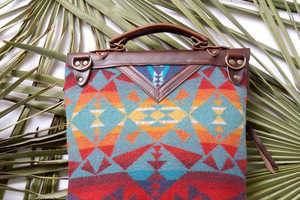Arc of a Diver's Handbags Feature Heavy Tribal Influences