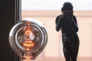 The Reflector Lamp is a Bare Bulb Lamp Design Dipped in Silver
