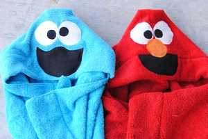 The 'Cookie Monster & Elmo Hooded Towel' is Perfect for Children