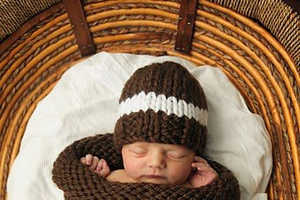 These Knitted Ball-Inspired Baby Wraps are Cute and Cozy