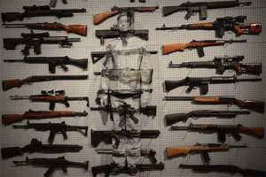 Artist Liu Bolin Became One with Weapons in the 'Gun Rack'