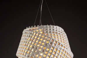 The Cmesh Collection Includes Lighting Fixtures and Tables
