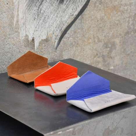 Minimalist Color Blocked Clutches - Invest in Classic Designs with the Secretaire Collection of Bags