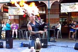 The Badpiper Rocks Out to AC/DC with Flames Shooting from His Pipes