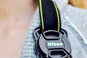 The Capbuckle Securely Fastens Camera Lens Caps Onto a Neck Strap