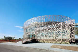 This Renovation Project has a Sun-Protecting Perforated Metal Shield