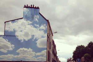 This Graffiti Artist Paints Realistic Cloudy Skies on Buildings