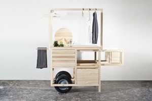 COS Releases a Minimalist Pop-Up Cart to Showcase its Stylish Clothes
