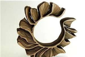 Laser Cut Wooden Bracelets by Anthony Roussel