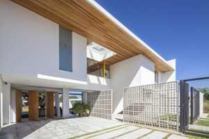 DOMO Arquitetos's Rectangular House is Simply Elegant