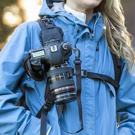 Hands-Free Camera Holsters - The StrapShot Keeps the Camera Secured to Your Bag Strap