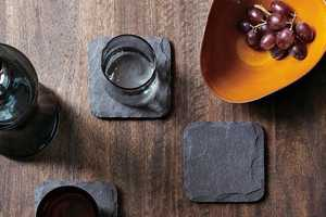 The Slate Coaster Set Adds a Flinty, Organic Feel to the Dining Table
