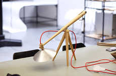 Distraction-Alleviating See-Saw Lamps