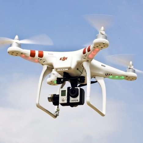 Camera-Mounted Quadcopters - The DJI Phantom Quadcopter has a Range of 300 Meters