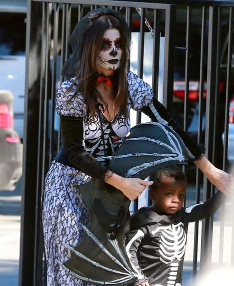 Thematic Celebrity Family Costumes - Sandra Bullock and Louis Recently Wore Twin Skeleton Costumes