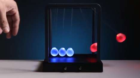 Kinetic Desktop Toys - The Kinetic Light Newton's Cradle is a Luminescent Version of the Class