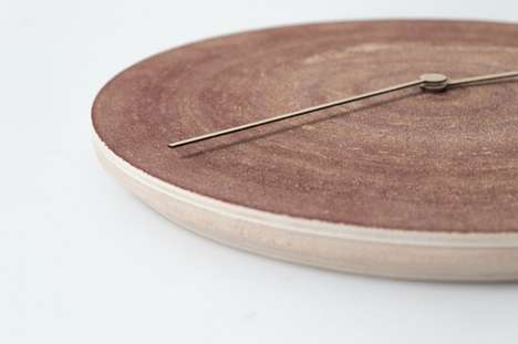 Sanding Disc Clocks - The Hand of Time by Qoowl Looks Like a Relic
