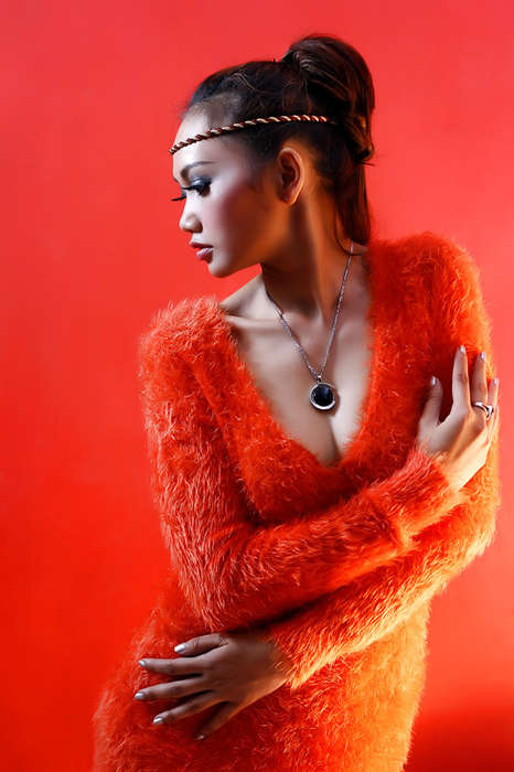 Futuristic Tribal Editorials - This Exotic Glamazon's Orange Outfit Packs Serious Punch