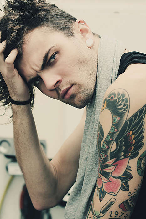 Sultry Tattooed Rocker Photography - Model Axel Swan Maldini's Intense Stare Will Give You Chi