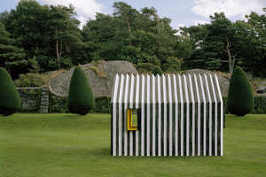 The Chameleon Cabin Masquerades as Black or White Marble, View Dependent