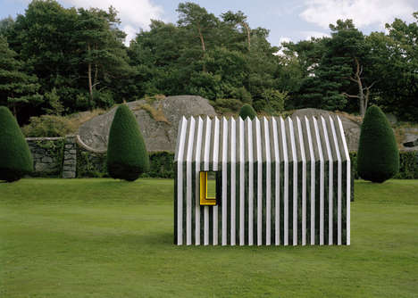 Cute Two-Faced Cottages - The Chameleon Cabin Masquerades as Black or White Marble, View Dependent