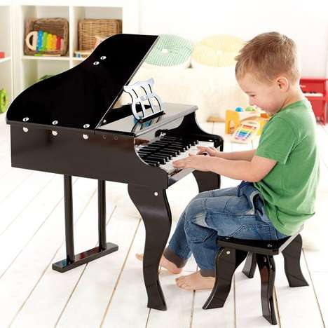 Literal Baby Grand Pianos - This Small Children's Piano From Hape  Helps Your Baby Play Thier