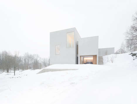 White Winter Abodes - This Winter Home is Nearly Invisible Against Snow