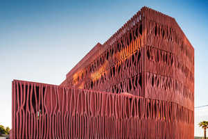 This Striking Coral Architecture is a Student Housing Building