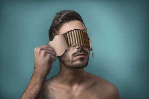 These Surreal Photos Show a Man Trying to Get Rid of His Own Face