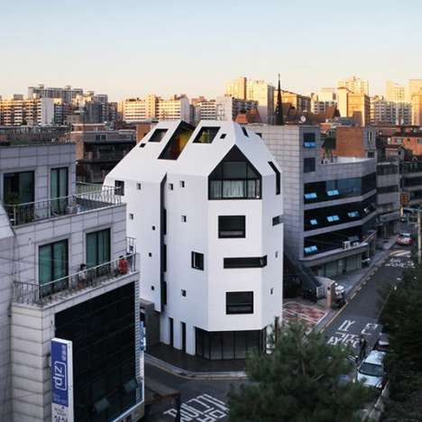 Futuristically-Shaped Apartments - The White House by YOAP Makes a Small Building Feel Much Bigger