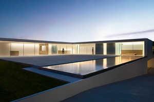 Silvestre's L-Shaped Atrium House Wraps Around a Central Courtyard