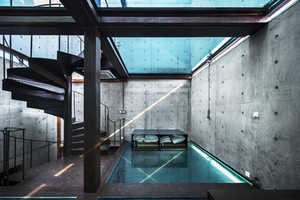 The Vertical Glass House Swaps Out Wooden Floors in Favor of Glass
