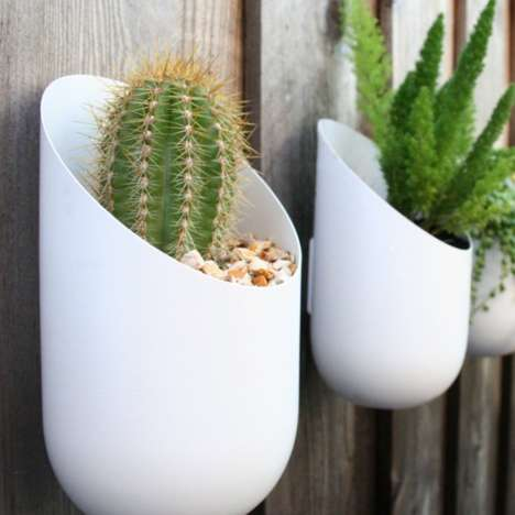 Wall-Mounted Pland Holders - A Wall Planter Will Really Up Your Outdoor Decor Game