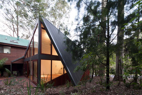 Angularly Folded Steel Structures - The Folded South Durras House Features a Floor-to-Roof Door