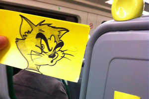 This Bored Artist Drew Cartoon Faces on His Fellow Commuters
