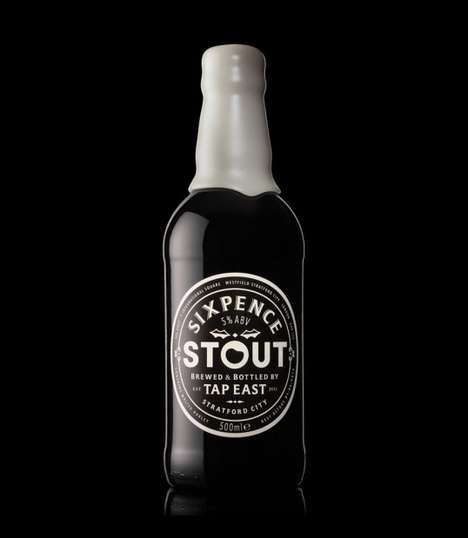 Froth-Topped Bottles - Sixpence Stout Packaging Features a Creamy Seal That Seems to Drip Down