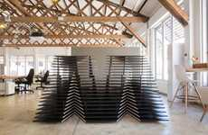 Slatted Alphabetic Desks - The MetropolitanRepublic Reception is a 3D Puzzle of the Firm's M-blem