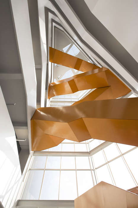 Angular Snakelike Staircases - The Orange Staircase Connects Six Floors with Its Snake-Like Body