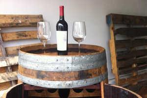 This Wine Rack Reuses Old Wooden Barrels for Its Design