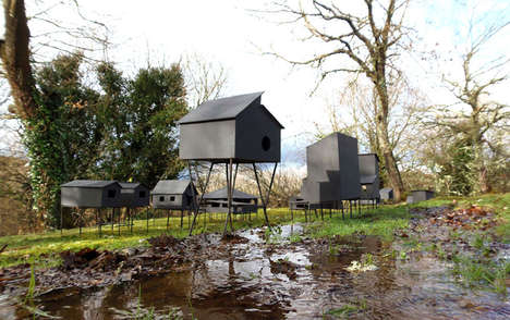 Elevated Somber Stilt Houses - These Small Symbolic Houses are Propped Up on Stilts