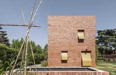 Minimalist Brick Abodes - House 1101 Has a Basic Masonry Front with Asymmetrically Excised Windows