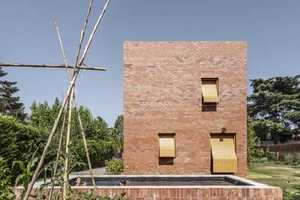 House 1101 Has a Basic Masonry Front with Asymmetrically Excised Windows