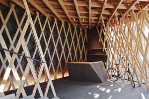 SunnyHills is Encased in an Elaborate Criss-Cross Latticework