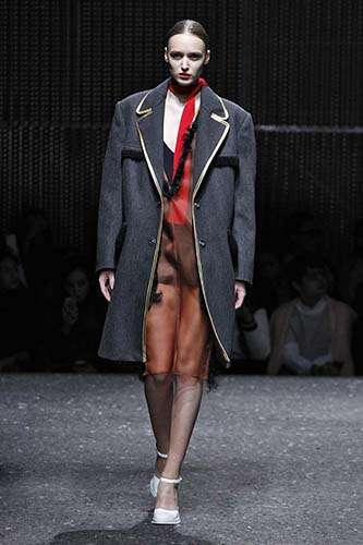 Gender-Diverging Fashion Collections - The Prada Fall 2014 Collection Contrasts Gendered Garments