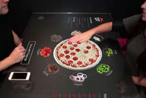 Touch Screen Pizza Parlors - The New Pizza Hut Interactive Screen Lets People Make Perfect Pizza