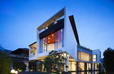 Fluid Boomerang Waterfront Houses - This Luxurious Waterfront Mansion is Soothing and Elegant