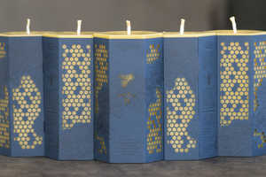 Worker B Candles Have Been Wrapped in Marvellous Hive Motifs